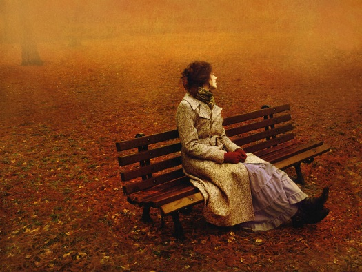 Lady on bench in Autumn